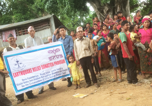 Team-holding-Seva-sign-with-villagers-gathered-around-300w.j
