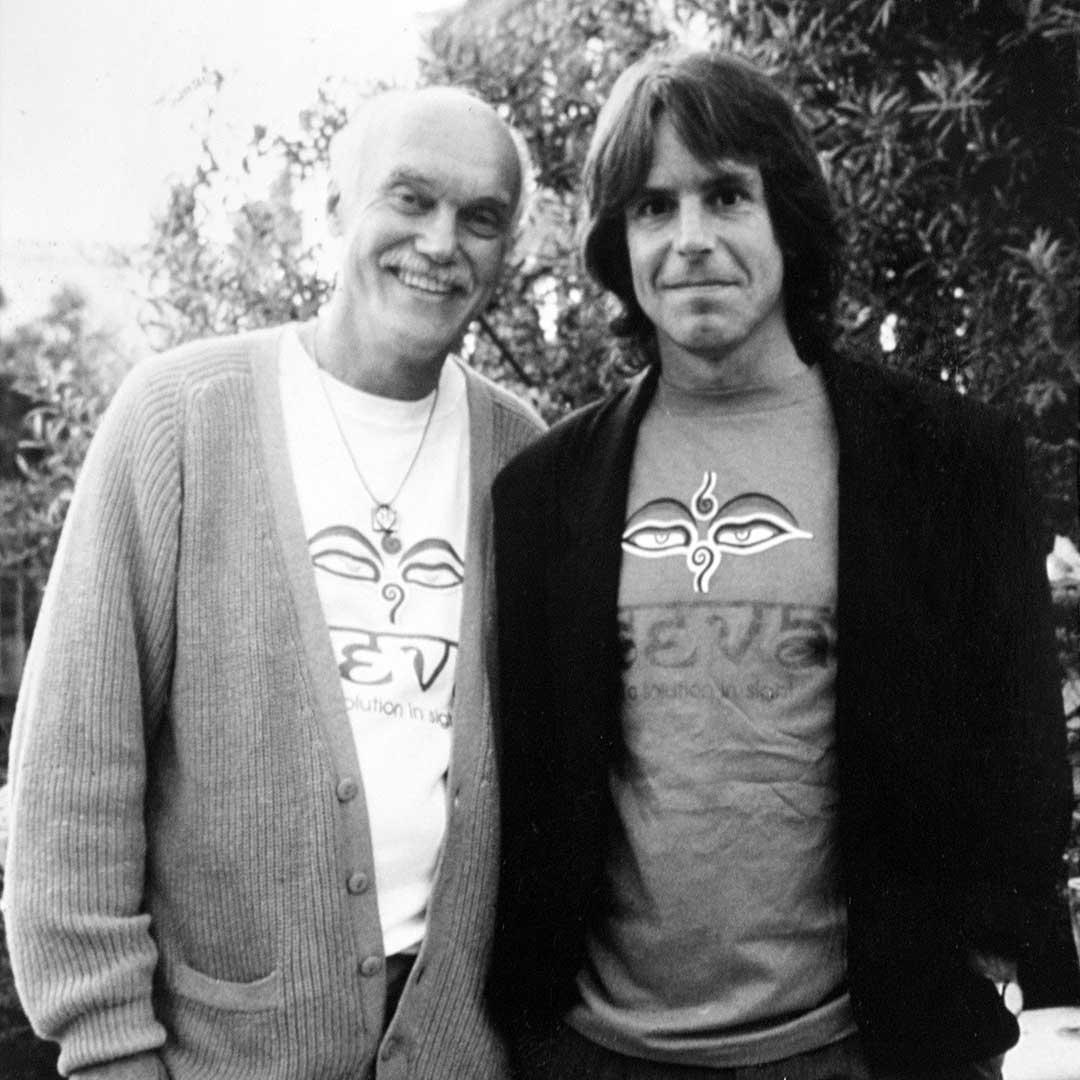 Ram Dass and Bob Weir wearing Seva shirts.